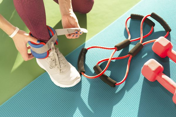 Woman putting on ankle weights