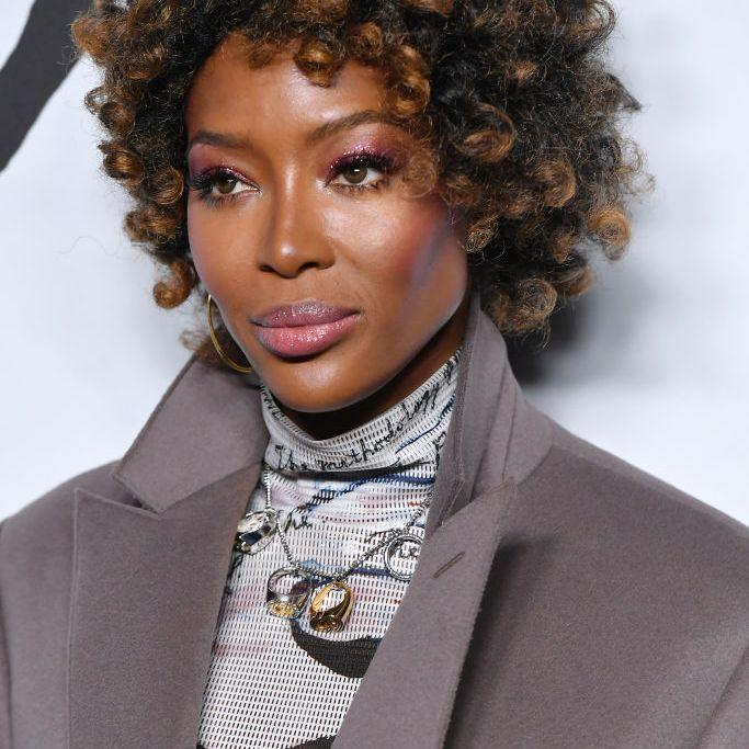 Naomi Campbell short curly natural hair with highlights