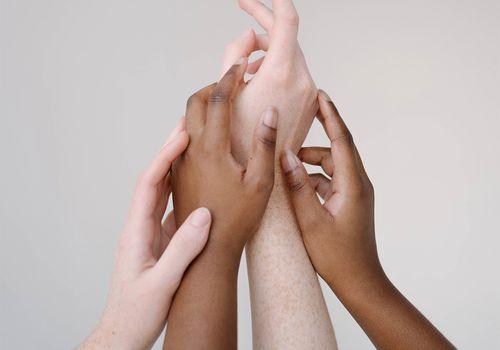hands of different skin tones