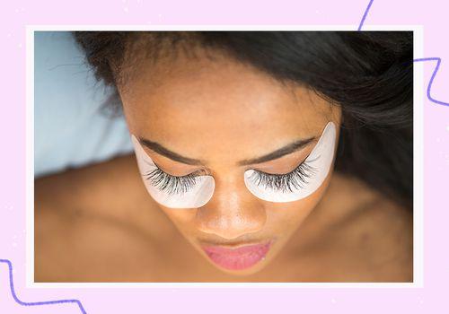 woman getting eyelash extensions