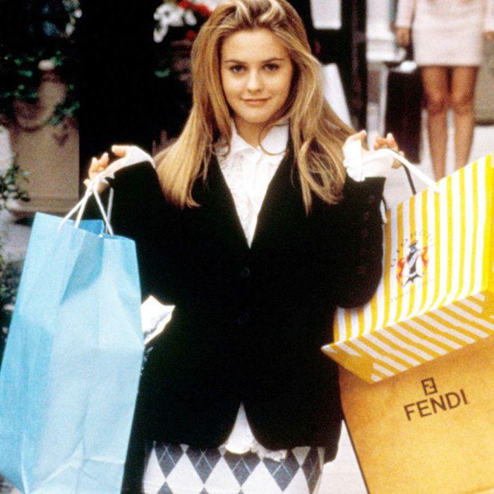 Alicia Silverstone as Cher holding shopping bags
