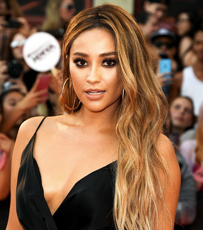 Shay Mitchell with caramel-colored hair