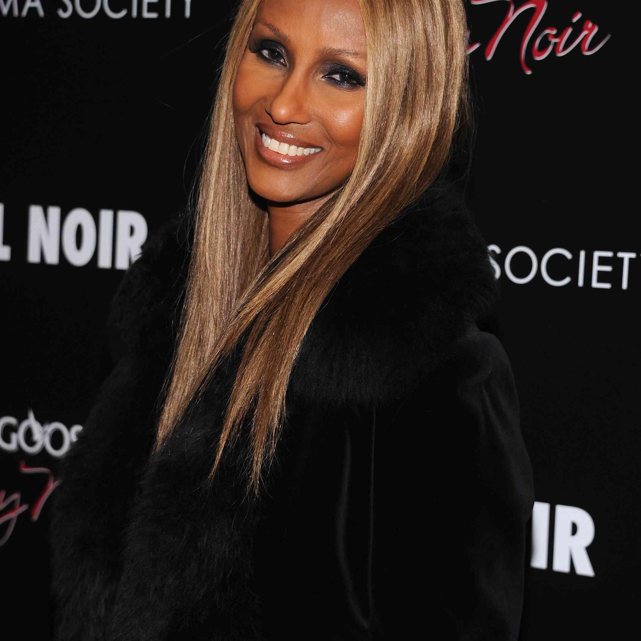 Iman long, sleek blonde hair
