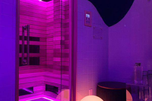 Purple-lit Infrared Sauna Treatment Room