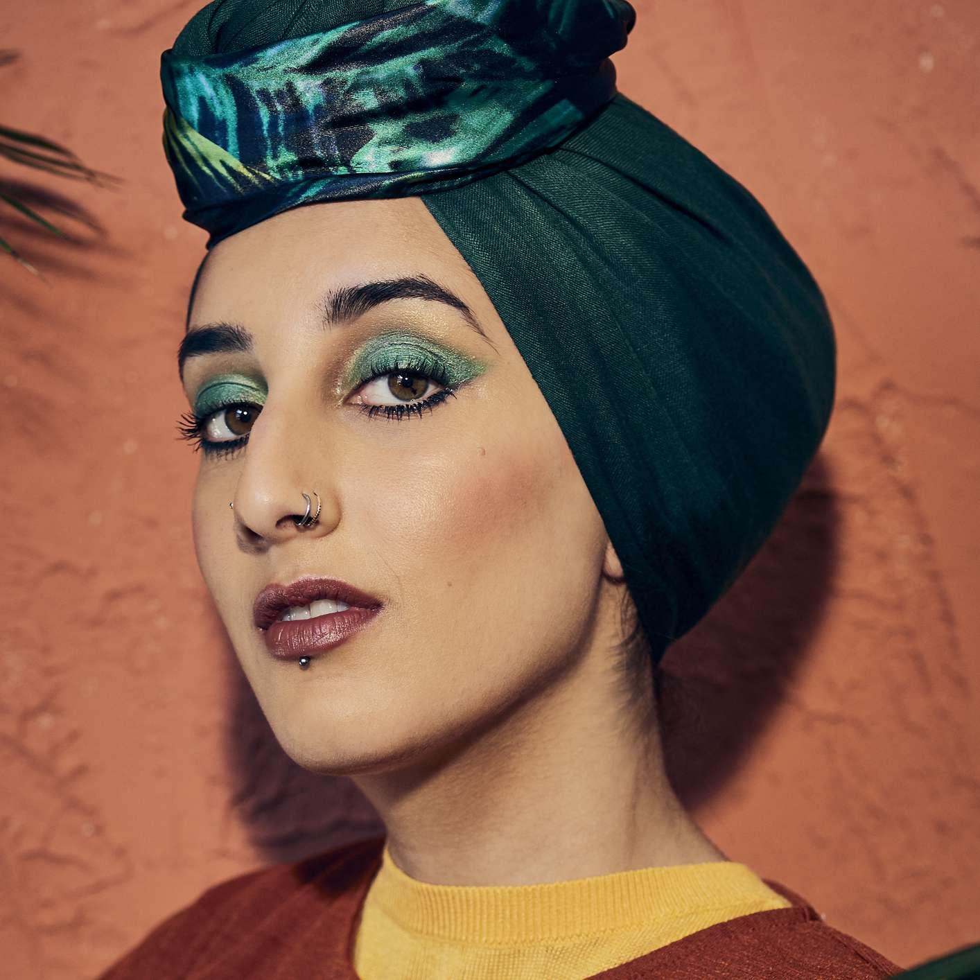 Woman in a green hijab