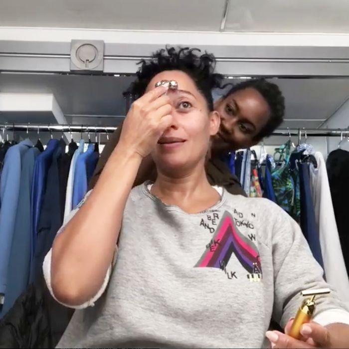 best skincare tools: Tracee Ellis Ross using a face roller