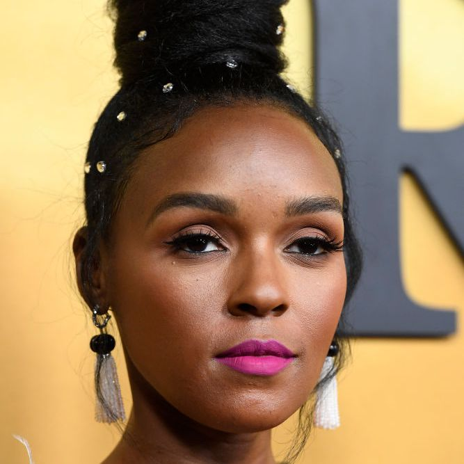 Janelle Monae topknot with hair crystals