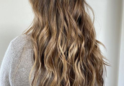 Back of woman's head with long, curled hair