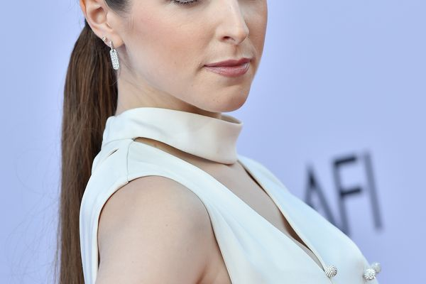 Anna Kendrick in a ponytail and white dress