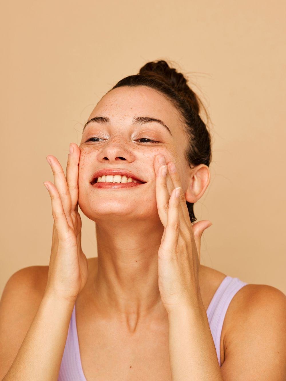 happy person using lite moisturizer