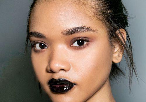 woman with dark black lipstick