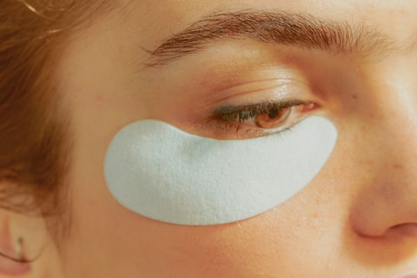 Young Woman Wearing an Undereye Mask