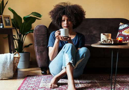 woman sitting drinking tea
