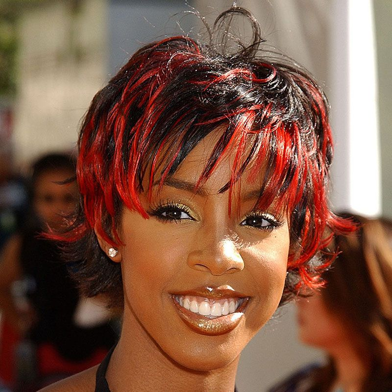 Kelly Rowland with chunky red highlights.