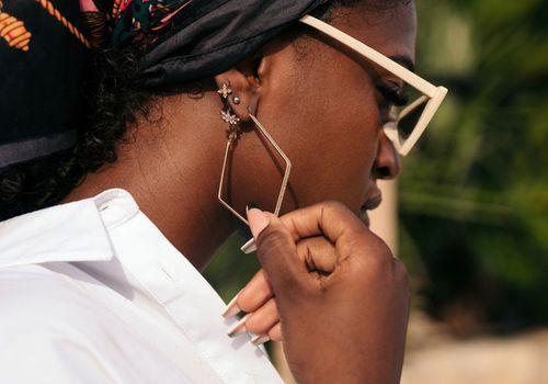 Woman with geometric earrings