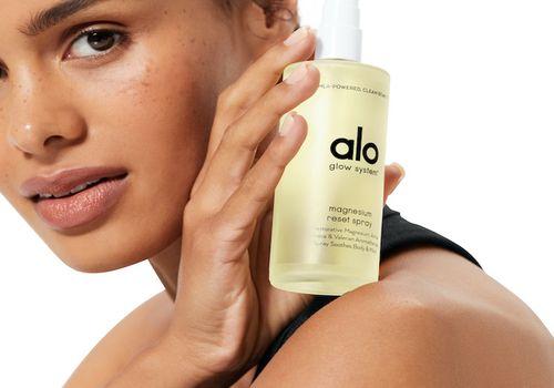 Alo Yoga model with Glow System spray