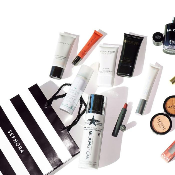Assortment of beauty products and Sephora bag