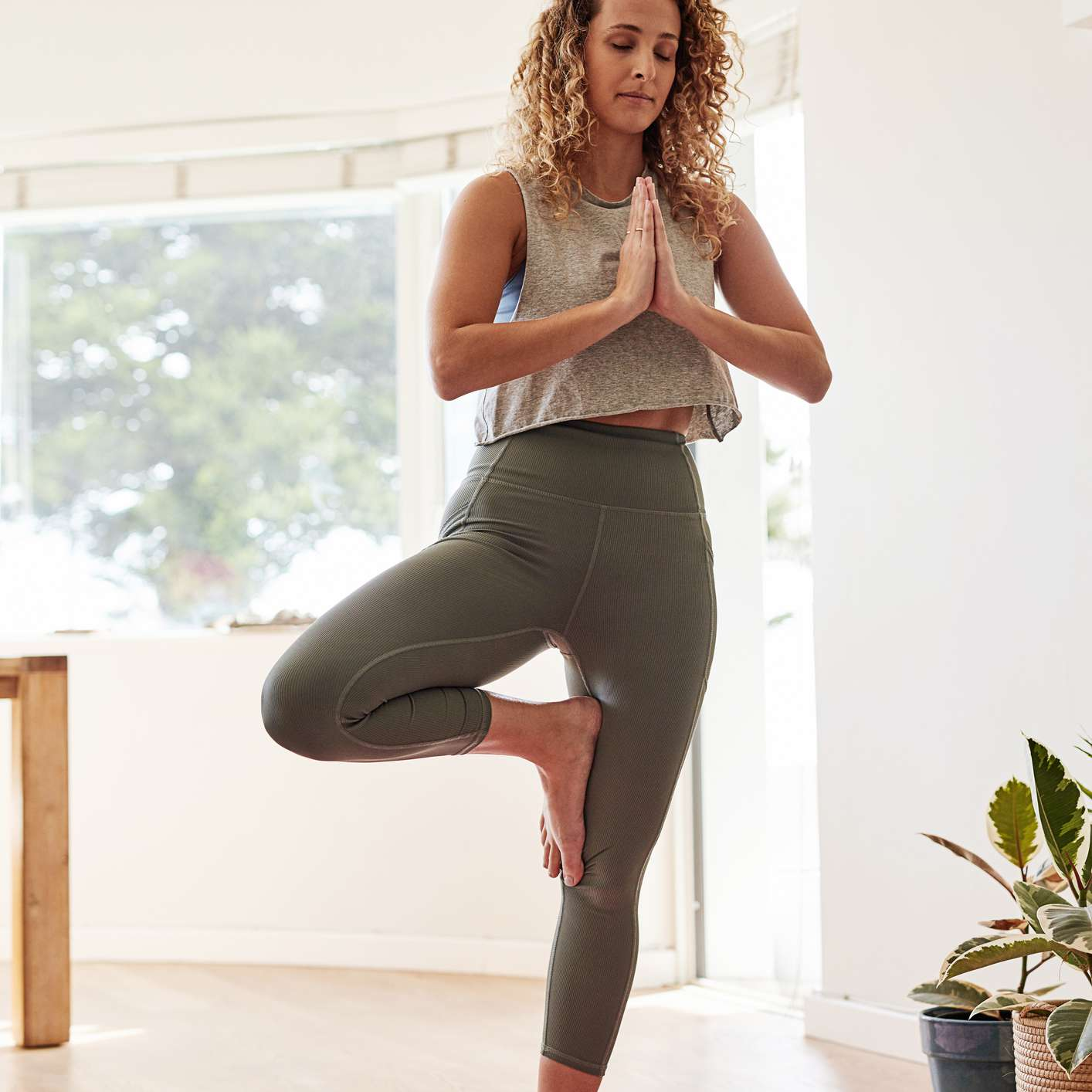 woman in tree pose at home