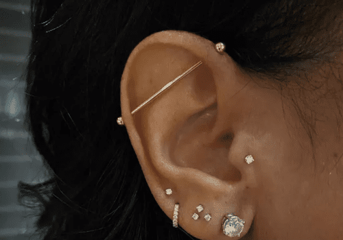 Woman with many ear piercings