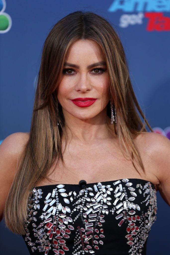 Sofia Vergara long straight hair with red lip