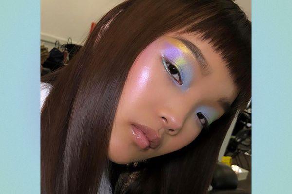 Woman wearing iridescent pastel eyeshadow.