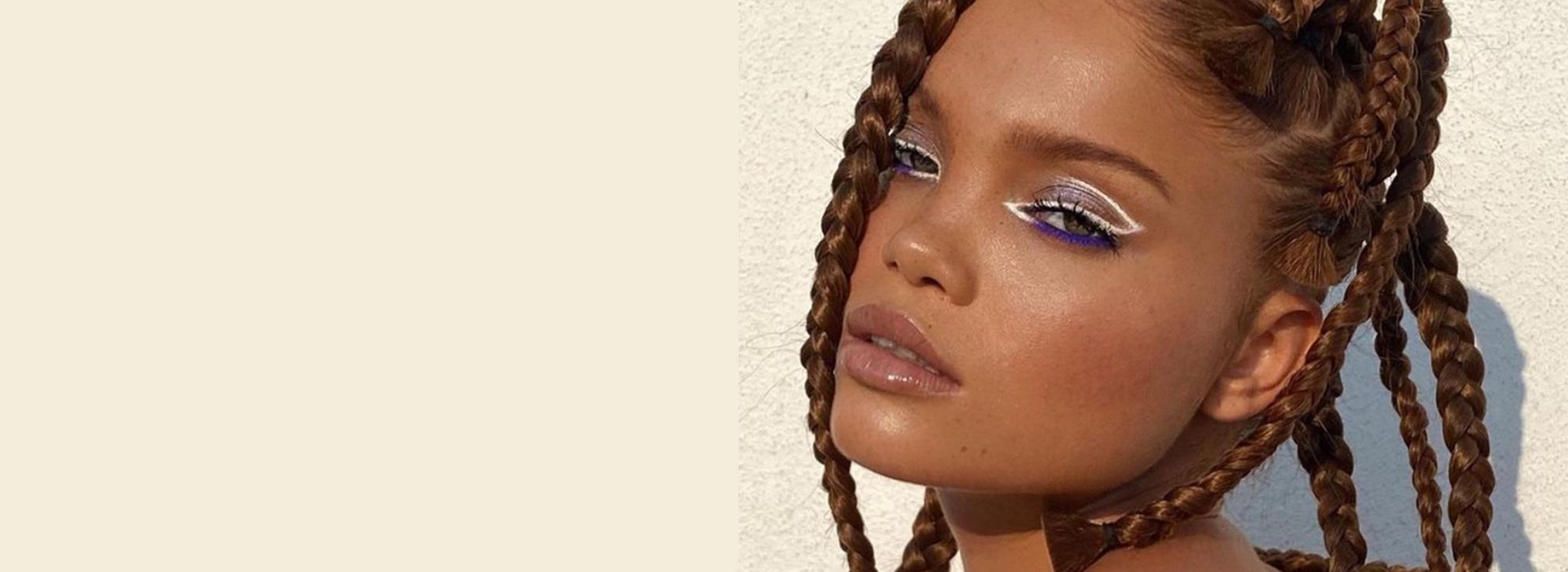 woman with box braids and graphic eyeliner