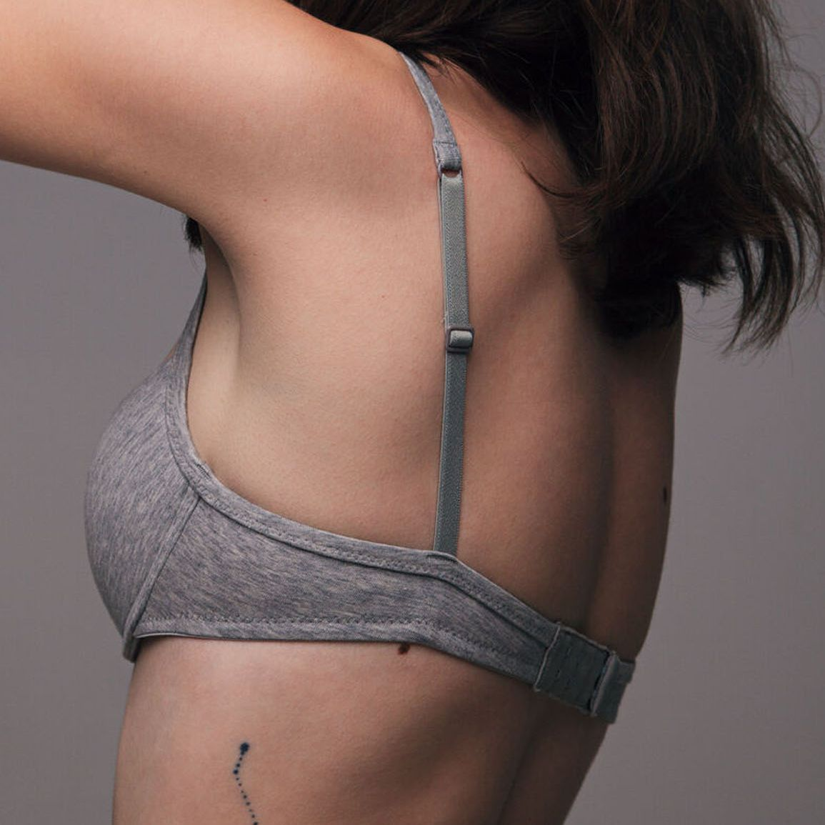 woman with a small tattoo on her side rib