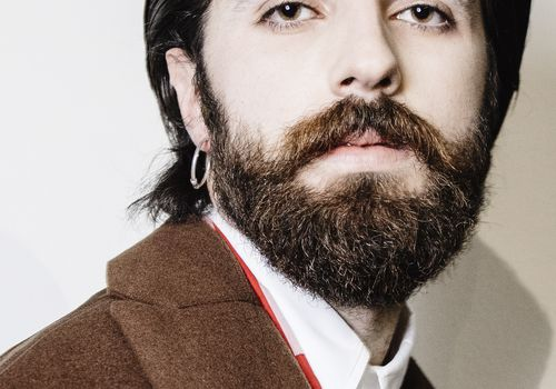 man with a beard and mustache at fashion week