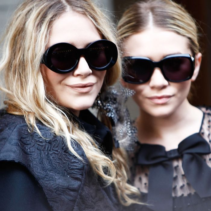 Mary-Kate and Ashley wearing big, black sunglasses