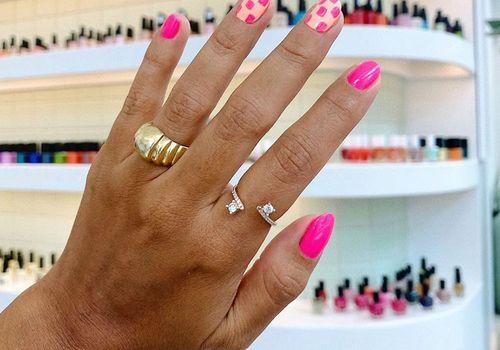 hand with pink nail polish
