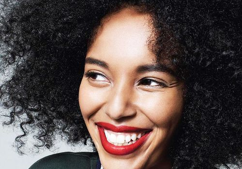 girl with curly hair and red lipstick