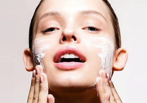 woman applying face wash