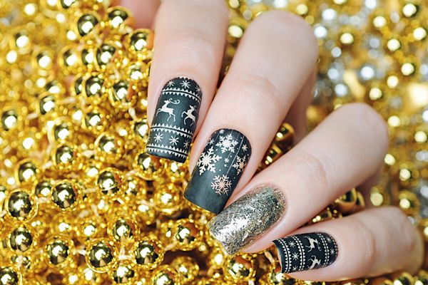 Black gold Christmas manicure with deer and snowflakes