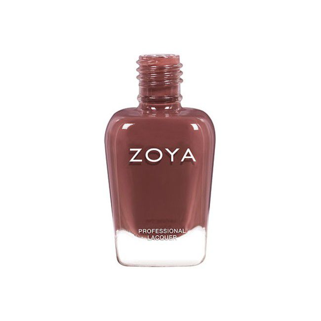 Bottle of spicy brown nail polish on a white background.