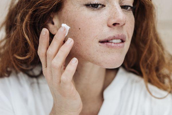 woman applying cold cream