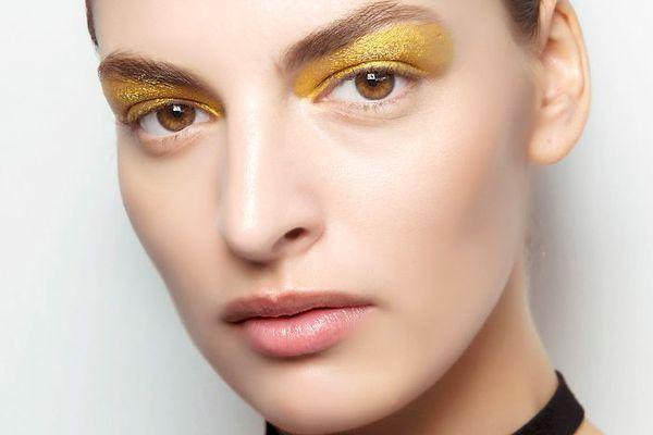 brunette woman with yellow eyeshadow
