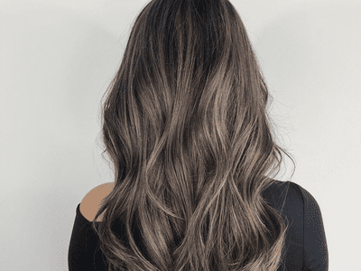 woman with long ash brown hair