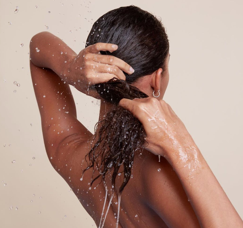 wringing out hair in shower