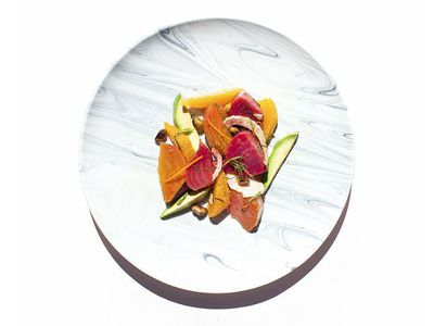 healthy lunch plate with sweet potato, beet, avocado, and onions