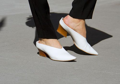 Woman wearing white stacked heels