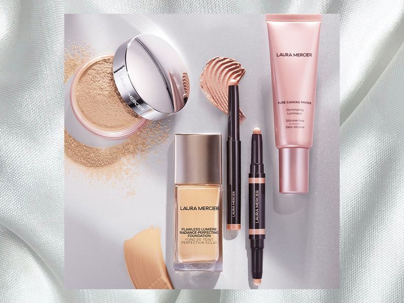 Laura Mercier products flat layed on a white background