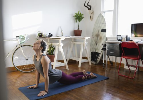 woman doing yoga in her apartment