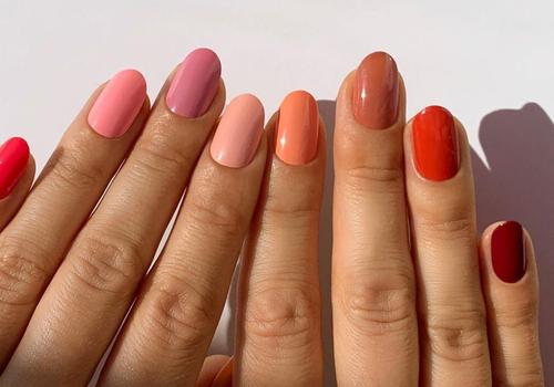 colorful acryllic nails on white background