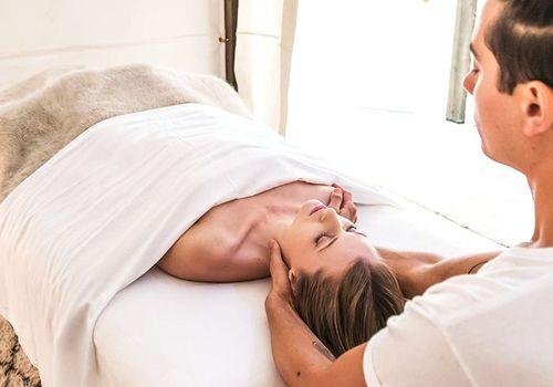 man giving woman a massage