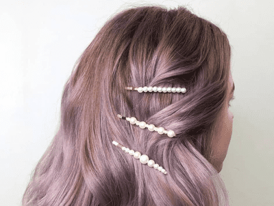 woman with pearl clips in lavender hair