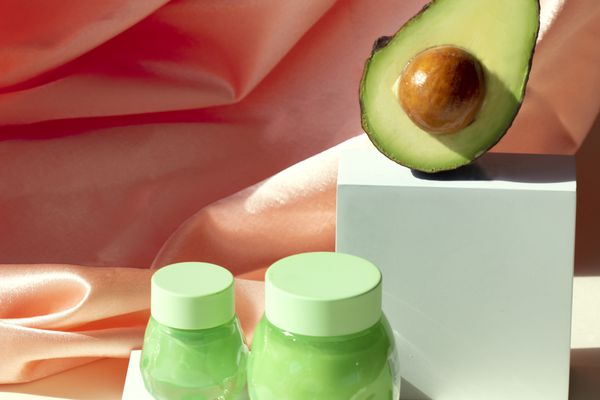 avocado and jars of lotion