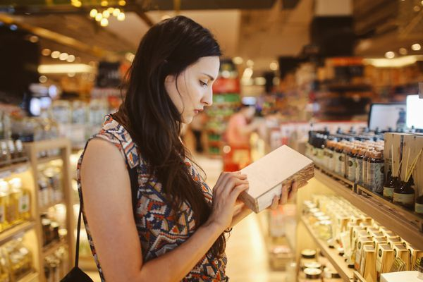 Brunette woman shopping for skincare products