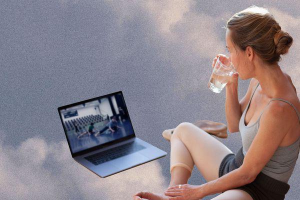 Woman watching ballet class on computer