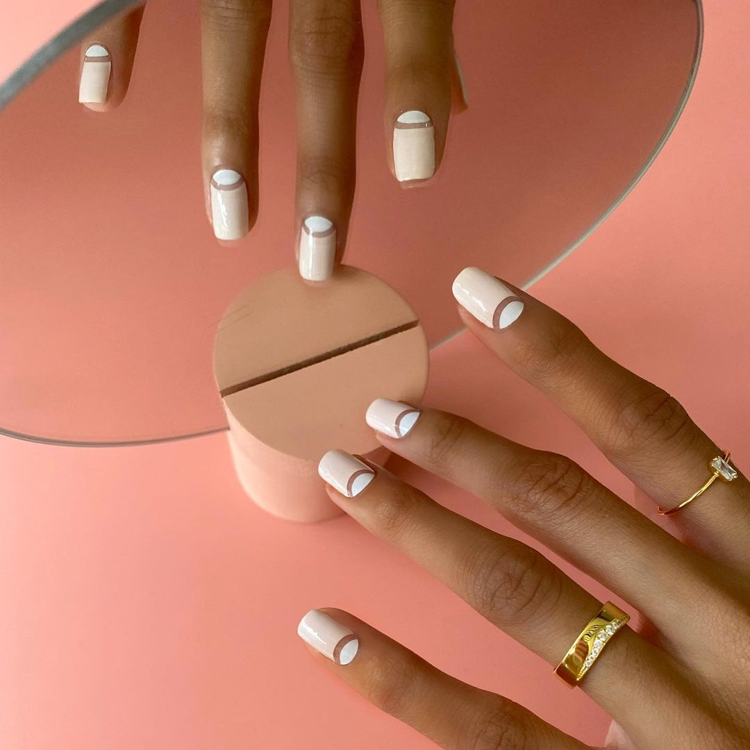 Person with two-toned negative space nails