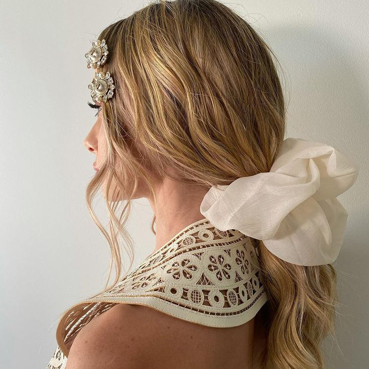 Low, crimpy, loose ponytail with accessories